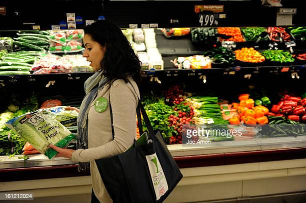 Renee Petrillo Shopping Matters coordinator looking at the difference in packaged romaine lettuce and fresh at King Soopers in Arvada Colorado...