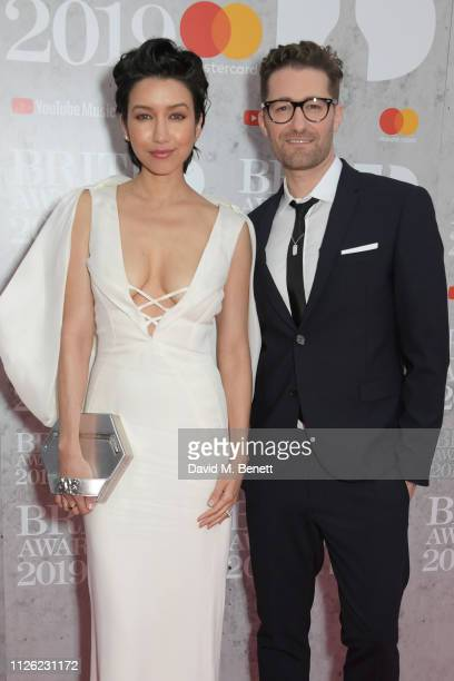 Renee Puente and Matthew Morrison arrive at The BRIT Awards 2019 held at The O2 Arena on February 20 2019 in London England