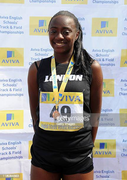 Renee RossGordon of London poses with her medal after placing 3rd in the Junior Girls 200 Metres during Day 2 of the Aviva English Schools Track...