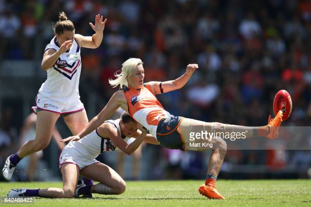Renee Tomkins of the Giants is tackled by Ashley Sharp of the Dockers during the Women's round three match between Greater Western Sydney Giants and...