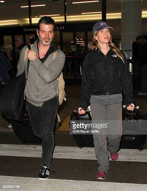 Renee Zellweger and Doyle Bramhall are seen at LAX on December 30 2015 in Los Angeles California