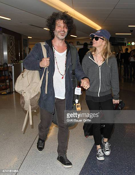 Renee Zellweger and Doyle Bramhall are seen at LAX on May 20 2015 in Los Angeles California