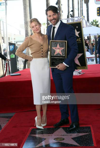 Renee Zellweger and Harry Connick Jr attend his being honored with a Star on Hollywood Walk of Fame on October 24 2019 in Hollywood California