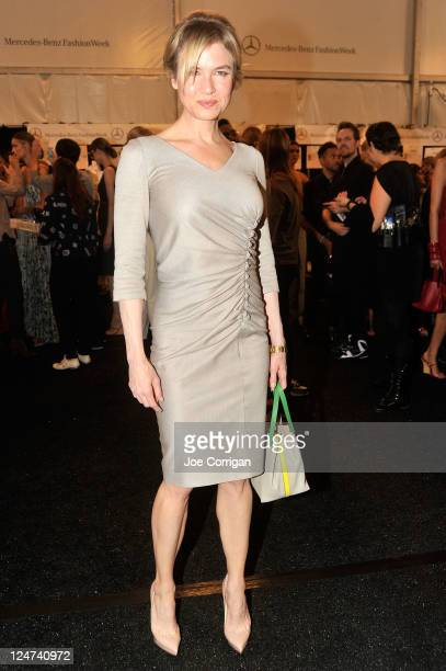 Renee Zellweger poses backstage at the Carolina Herrera Spring 2012 fashion show during MercedesBenz Fashion Week at The Theater at Lincoln Center on...