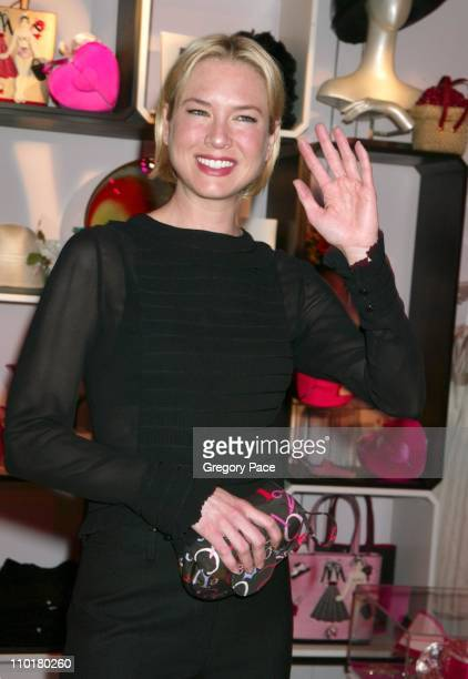 Renee Zellweger wearing a Chanel blouse and holding one of the cosemetic bags designed by NickNora with a portion of the sales proceeds from the bag...