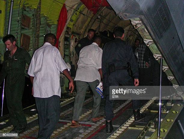Renegade Comoran leader Mohamed Bacar boards a French military plane on March 27 2008 in Pamandzi on the French Indian Ocean territory of Mayotte...