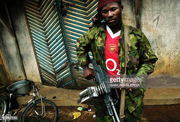 Renegade Congolese soldier from the CRD eastern Congo former rebellion, stands, 16 December 2004, outside a looted shop in Kanya Bayonga town, some...