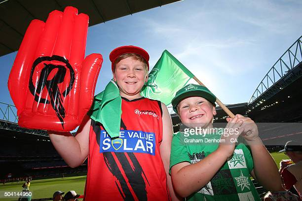 Renegades fan and a Stars fan show their support during the Big Bash League match between the Melbourne Renegades and the Melbourne Stars at Etihad...