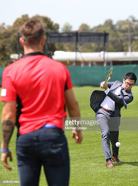 Renegades fast bowler James Pattinson bowls to City of Maribyrnong Mayor Nam Quach at the Melbourne Renegades Big Bash League season launch at Merv...