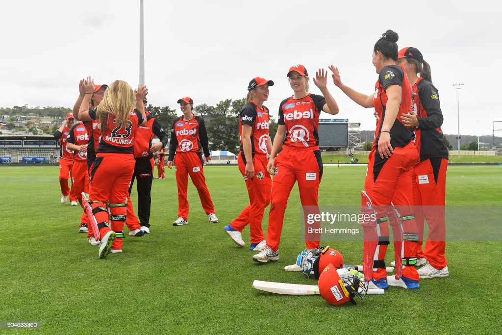Renegades players celebrate victory during the Women's Big Bash League match between the Melbourne Renegades and the Hobart Hurricanes at Blundstpne Arena on January 14, 2018 in Hobart, Australia.