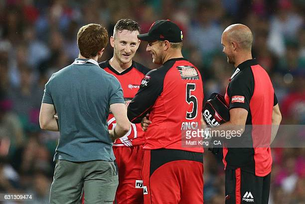 Renegades wicketkeeper Peter Nevill is assessed by medical staff after being hit in the head by the ball during the Big Bash League match between the...