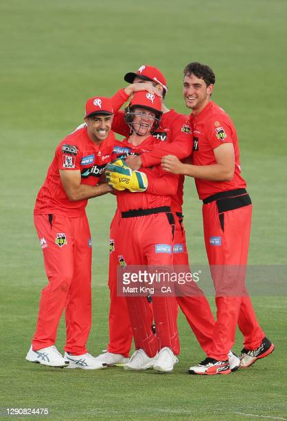 Renegades wicketkeeper Sam Harper celebrates with team mates after running out Ashton Turner of the Scorchers during the Big Bash League match...