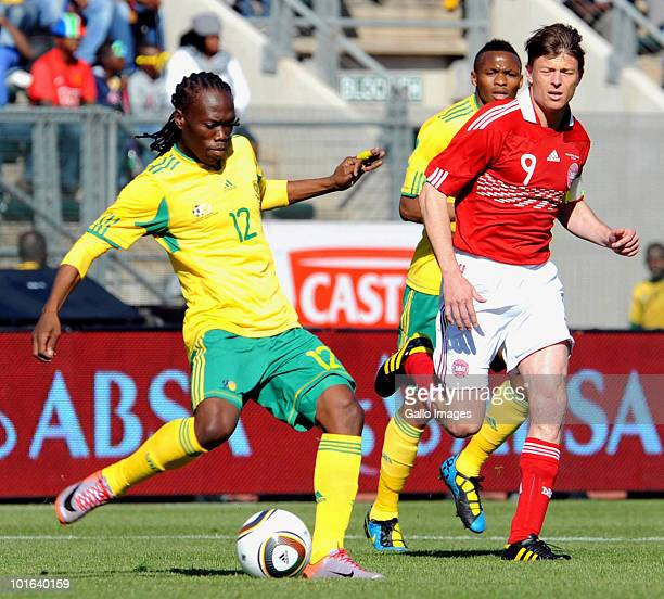 Reneilwe Letsholonyane of South Africa and Jon Dahl Tomasson in action during the International friendly match between South Africa and Denmark at...