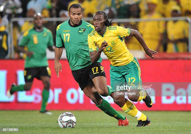 Reneilwe Letsholonyane of South Africa is chased by Rodolph Austin of Jamaica during the International Friendly match between South Africa and...