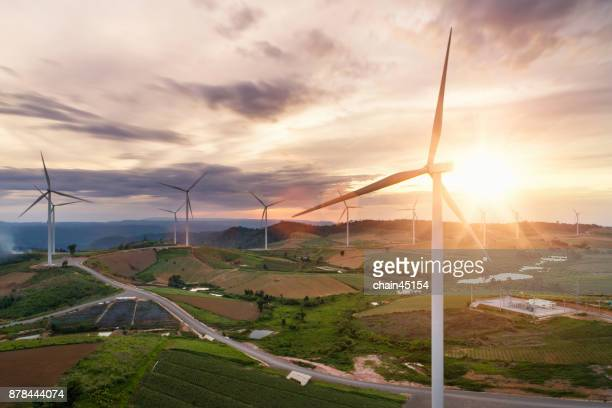 renewable energy by wind turbine for green energy world. - energieindustrie stock-fotos und bilder
