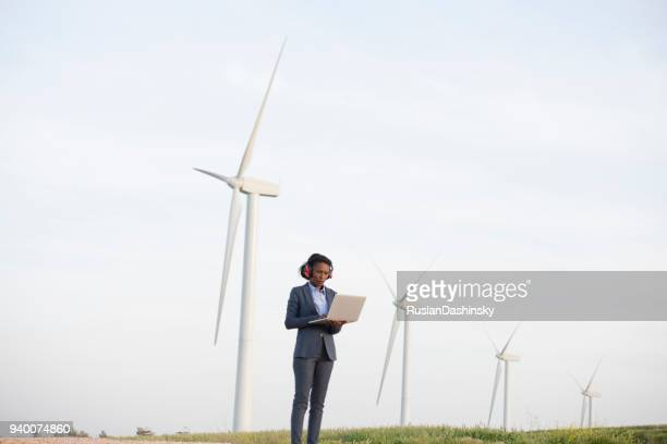 renewable energy engineer woman at wind farm. - internet of things stock pictures, royalty-free photos & images