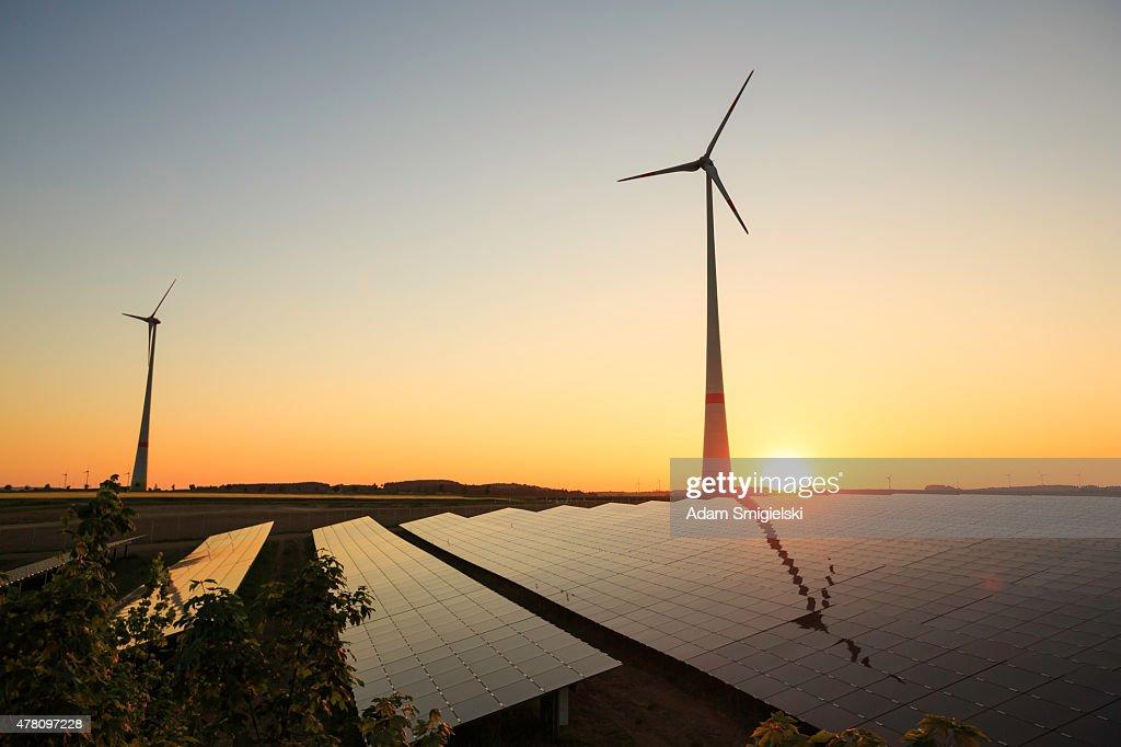 renewable energy: wind turbines and modern solar panels : Stock Photo