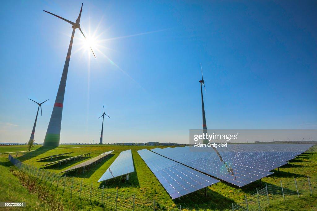 renewable energy: wind turbines and modern solar panels (HDRi) : Stock Photo