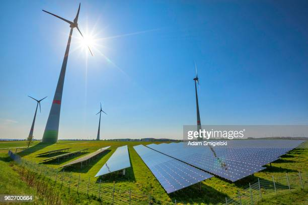 renewable energy: wind turbines and modern solar panels (hdri) - suns stock photos and pictures