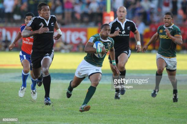 Renfred Dazel of South Africa on his way to score during the IRB Sevens Series final between South Africa and New Zealand December 6 2008 held at...