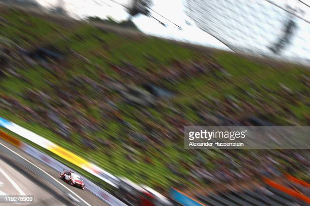 Renger van der Zande from Netherlands and stern AMG Mercedes drives during the qualifying round at Olympiastadion on July 16 2011 in Munich Germany