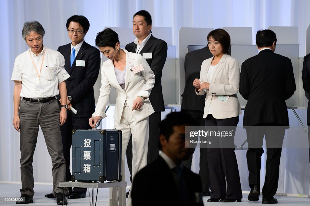 Renho Murata, a candidate for president of the Democratic Party of Japan (DPJ), third left, casts a vote into a ballot box during the party's leadership election in Tokyo, Japan, on Thursday, Sept. 15, 2016. Renho, a half-Taiwanese former newscaster, was elected as leader of Japan's main opposition Democratic Party, despite criticism over a last-minute revelation that she had dual nationality. Photographer: Akio Kon/Bloomberg via Getty Images