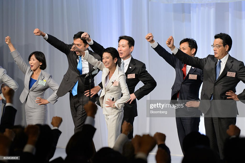 Renho Murata, president-elect of the Democratic Party of Japan (DPJ), fourth right, gestures following the party's leadership election in Tokyo, Japan, on Thursday, Sept. 15, 2016. Renho, a half-Taiwanese former newscaster, was elected as leader of Japan's main opposition Democratic Party, despite criticism over a last-minute revelation that she had dual nationality. Photographer: Akio Kon/Bloomberg via Getty Images
