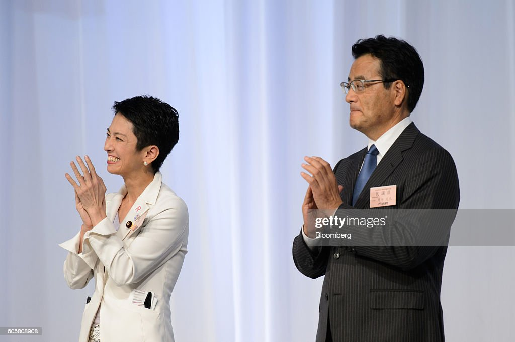 Renho Murata, president-elect of the Democratic Party of Japan (DPJ), left, and Katsuya Okada, outgoing president and founder of DPJ, applause following the party's leadership election in Tokyo, Japan, on Thursday, Sept. 15, 2016. Renho, a half-Taiwanese former newscaster, was elected as leader of Japan's main opposition Democratic Party, despite criticism over a last-minute revelation that she had dual nationality. Photographer: Akio Kon/Bloomberg via Getty Images