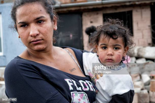 Reni a mother of four holds her youngest of four children Maya after her home was razed in a Roma quarter of Sofia At least 20 homes deemed illegal...