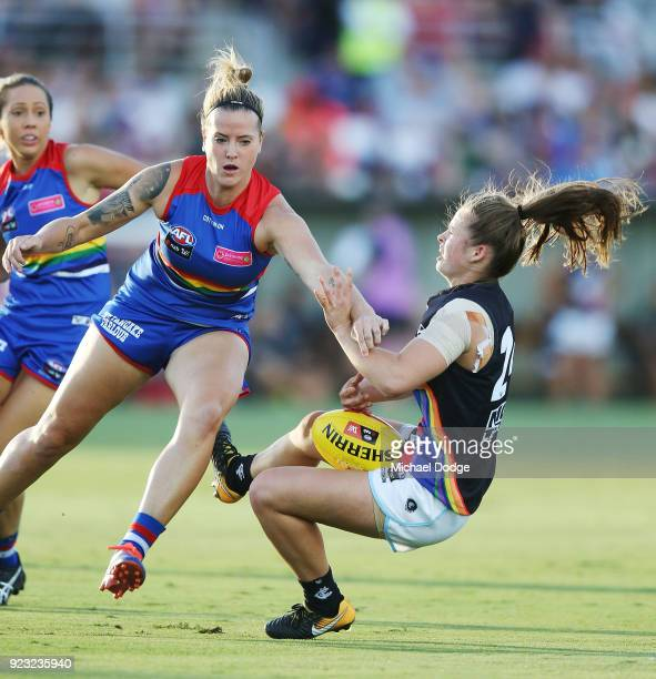 Reni Hicks of the Blues is hit hard by Hannah Scott of the Bulldogs during the round four AFLW match between the Western Bulldogs and the Carlton...