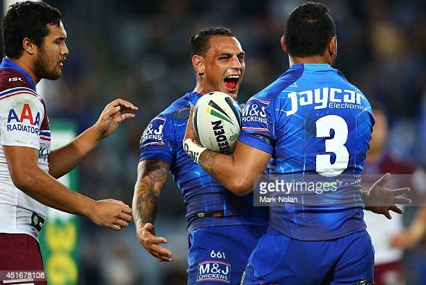 Reni Maitua of the Bulldogs celebrates with team mate Krisnan Inu after Inu scored a try during the round 17 NRL match between the Canterbury...