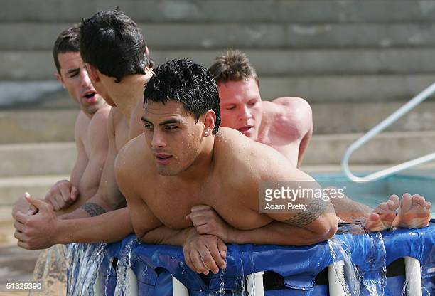 Reni Maitua of the Bulldogs shares an ice bath with Corey Hughes and others during a recovery session after the second week of the NRL finals between...