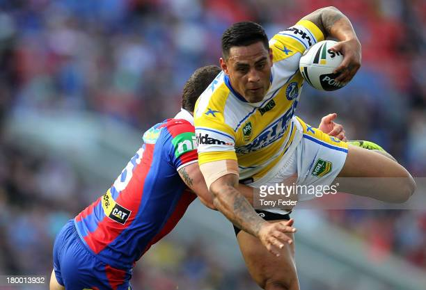 Reni Maitua of the Eels is tackled during the round 26 NRL match between the Newcastle Knights and the Parramatta Eels at Hunter Stadium on September...
