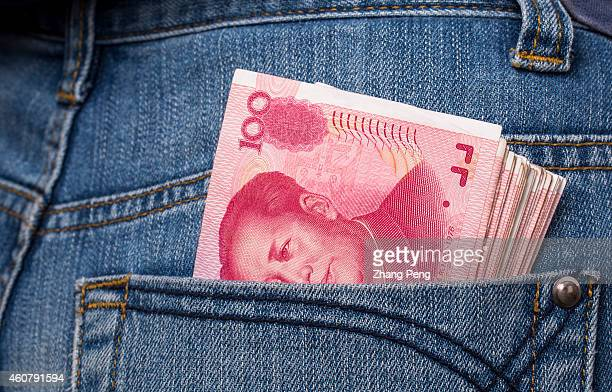 Renminbi banknotes in a jeans pant pocket Amid a strong US dollar and slower economic growth China has seen its currency under depreciation pressure...