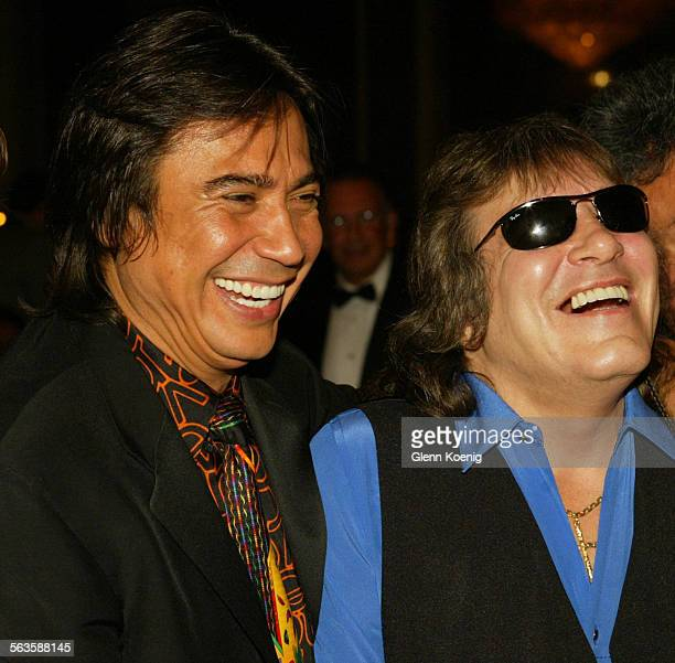 Renàn Almendàrez Coello and Josè Feliciano joke around while posing for photographs during the Gala Extravaganza benefiting the El Cucuy Foundation...