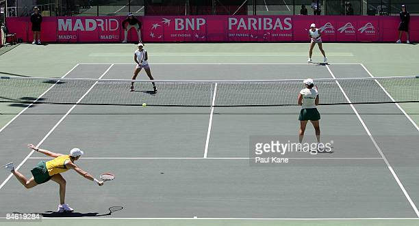 Rennae Stubbs and Casey Dellacqua of Australia play Lee JinA and Chang Kyung Mi of Korea during the doubles match in the first round Fed Cup match...