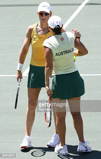 Rennae Stubbs and Casey Dellacqua of Australia talk tactics during the doubles match in the first round Fed Cup match between Australia and Korea at...
