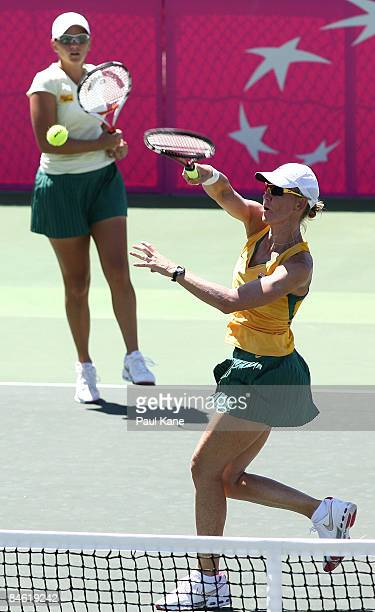 Rennae Stubbs of Australia returns a shot to Lee JinA of Korea during the doubles match in the first round Fed Cup match between Australia and Korea...