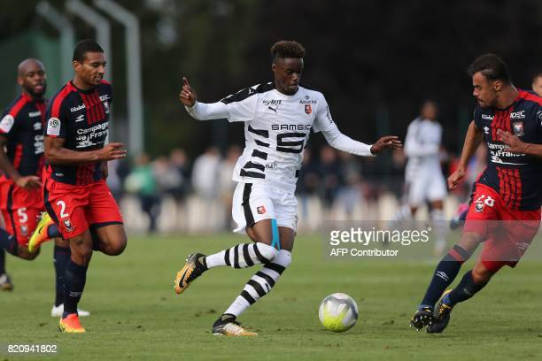 Rennes' Adama Diakhaby vies for the ball with Caen's French defender Damien Da Silva and Alexander Djiku during the French L1 football friendly match...