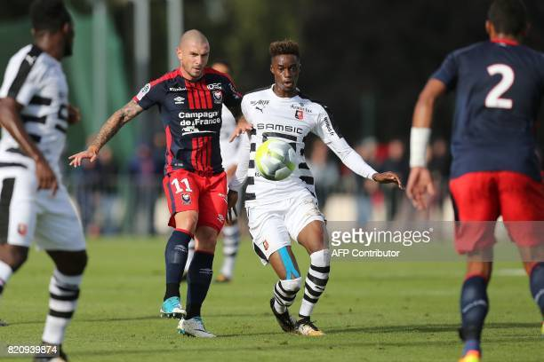 Rennes' Adama Diakhaby vies for the ball with Caen's French midfielder Vincent Bessat during the French L1 football friendly match between Caen and...