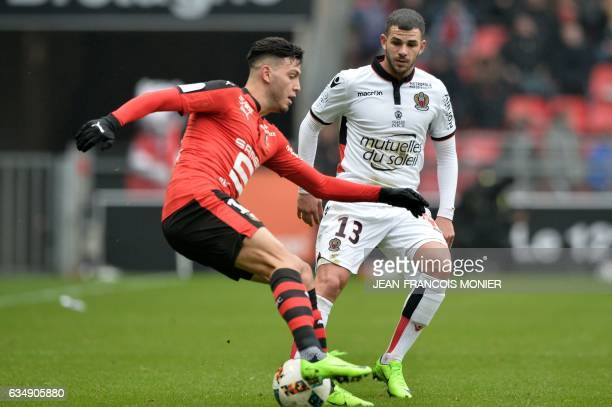 Rennes' Algeria defender Ramy Bensebaini vies with Nice's Tunisian forward Bassem Srarfi during the French L1 football match between Rennes and Nice...