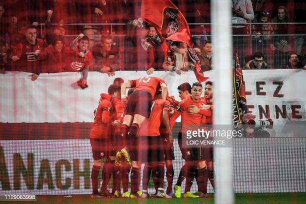 Rennes' Algerian defender Mehdi Zeffane celebrates with teammates after scoring their second goal during the UEFA Europa League round of 16 first leg...