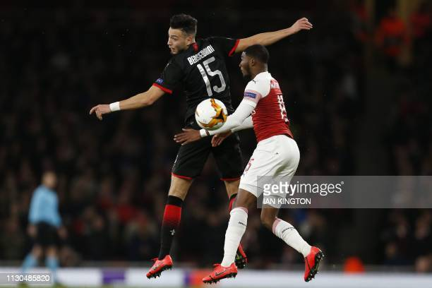Rennes' Algerian defender Rami Bensebaini vies with Arsenal's English midfielder Ainsley MaitlandNiles during the UEFA Europa League Round of 16...