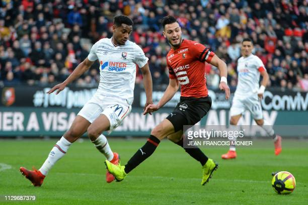 Rennes' Algerian defender Ramy Bensebaini fights for the ball with Caen's French defender Younn Zahary during the French L1 football match between...