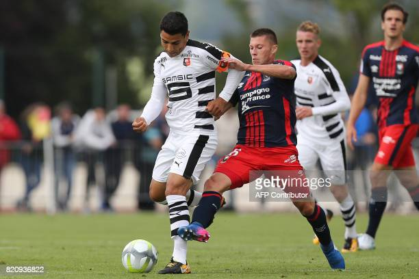Rennes' Benjamin Andre vies for the ball with Caen's French midfielder Jonathan Delaplace during the French L1 football friendly match between Caen...