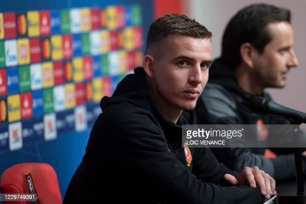 Rennes' coach Julien Stephan and Rennes' French midfielder Benjamin Bourigeaud give a press conference at the Roazhon Park stadium in Rennes, western...