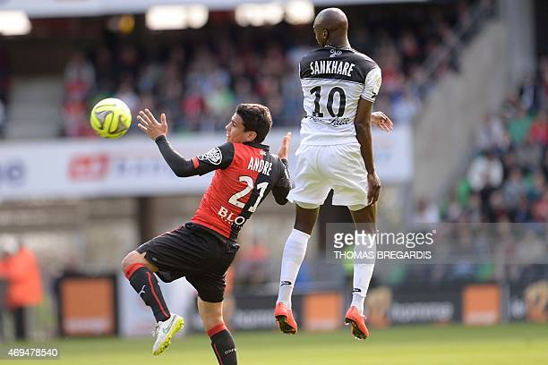Rennes' defender Benjamin Andre vies with Guingamp' midfielder Younousse Sankhare during the French L1 football match between Rennes and Guingamp on...