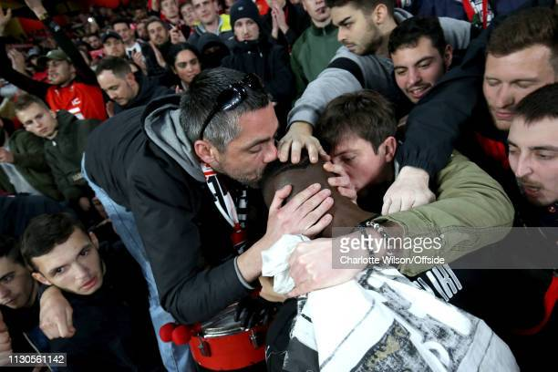Rennes fans comfort the dejected James Lea Siliki by kissing and patting his head during the UEFA Europa League Round of 16 Second Leg match between...