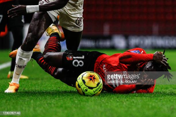 Rennes' forward Jeremy Doku falls down during the French L1 football match between Stade Rennais FC and FC Metz at The Roazhon Park stadium in...