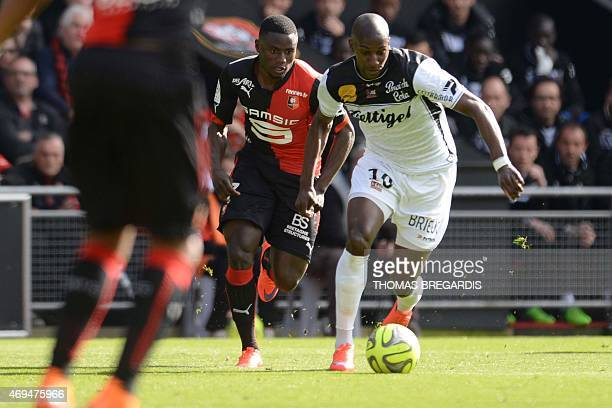 Rennes' forward PaulGeorges Ntep vies with Guingamp' midfielder Younousse Sankhare during the French L1 football match between Rennes and Guingamp on...